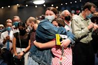 <p>Audience members hugged after the show concluded. </p>