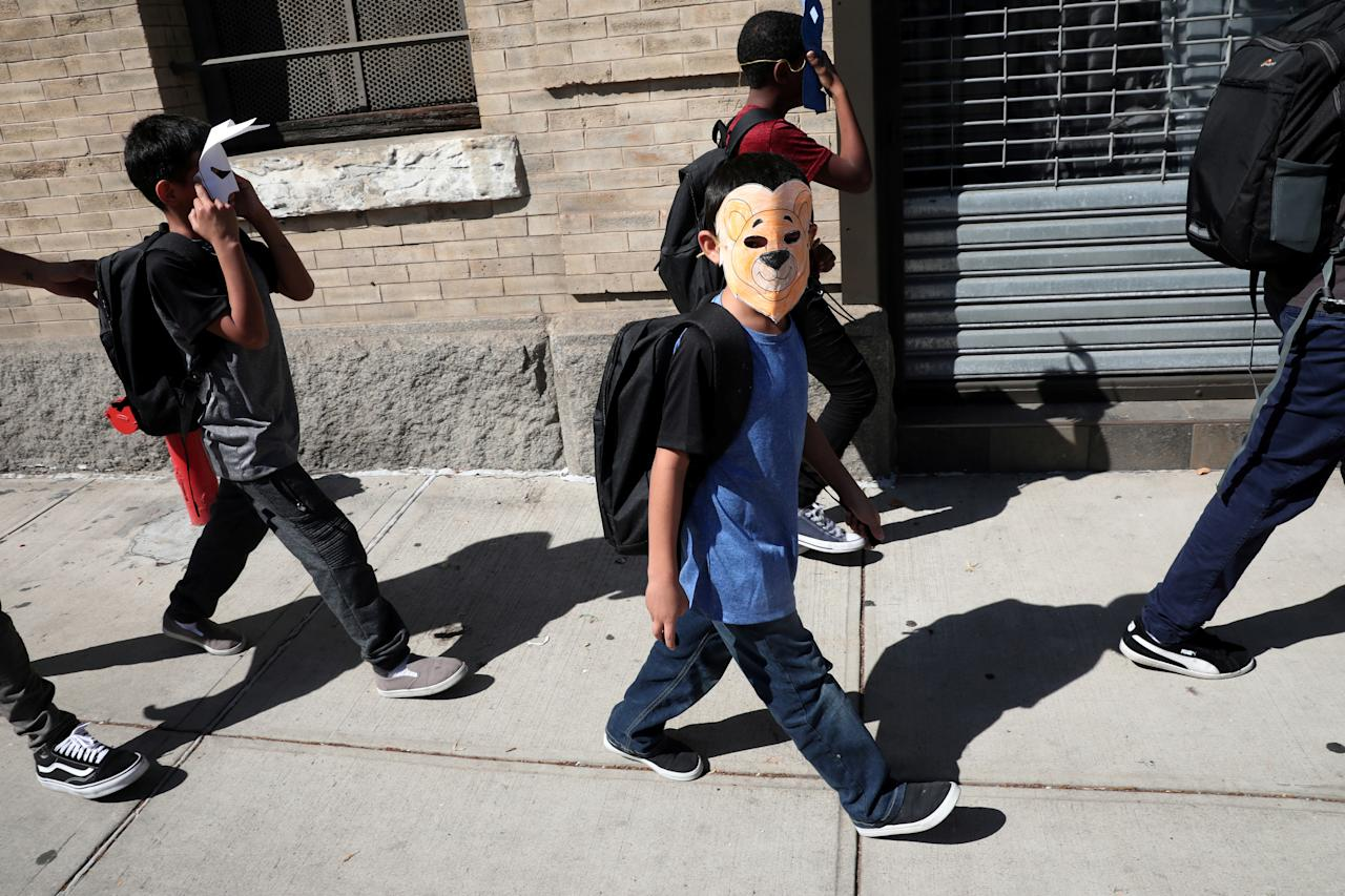 <p>Children, with their faces covered with masks, leave the Cayuga Center, which provides foster care and other services to immigrant children separated from their families, in New York City, June 21, 2018. (Photo: Mike Segar/Reuters) </p>