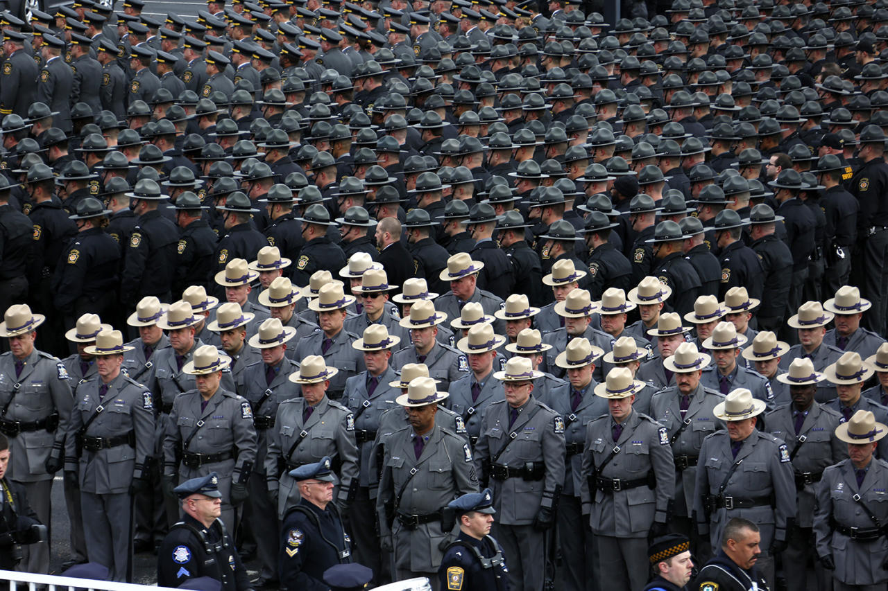 <p>Pennsylvania State Troopers and police officers from around the country line up outside the Blair County Convention Center in Altoona, Pa., following a memorial service, Jan. 5, 2017, for Pennsylvania State Trooper Landon E. Weaver, who was killed in the line of duty Dec. 30. Weaver, 23, had been on the force for less than six months. (Photo: Gene J. Puskar/AP) </p>