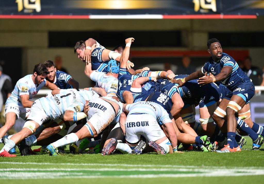 Montpellier's players and Racing 92's players fight for the ball in a scrum during the French Top 14 Rugby union match on May 20, 2017 (AFP Photo/PASCAL GUYOT)