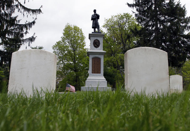 In this April 27, 2012 photo, a monument to the Civil War is seen over graves of soldiers who died in action or after the war at Albany Rural Cemetery in Menands, N.Y. Nearly 150 years after the last fusillade of the Civil War, historians, authors and museum curators are still finding new topics to explore as the nation commemorates the sesquicentennial of America's bloodiest conflict. Even the long-accepted death toll of 620,000, cited by historians since 1900, is being reconsidered. In a study published late last year in Civil War History, Binghamton University history demographics professor J. David Hacker said the toll is actually closer to 750,000. (AP Photo/Mike Groll)
