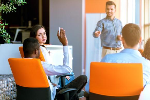 Corporate training class in contemporary office setting.