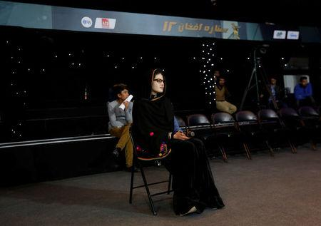 Zulala Hashimi 18,  a singer finalist of the music contest 'Afghan Star', waits for her turn to perform during a rehearsal for the show in Kabul, Afghanistan March 19, 2017. REUTERS/Mohammad Ismail