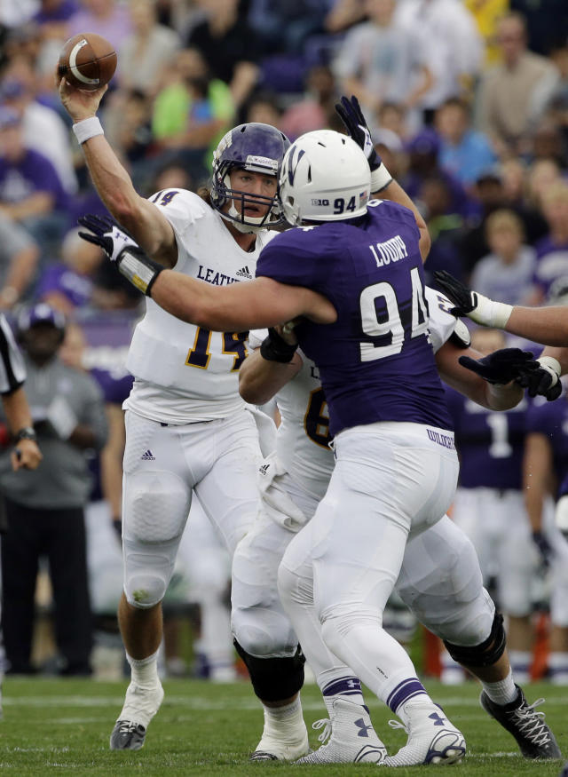 Western Illinois quarterback Trenton Norvell (14) throws against Northwestern defensive line Dean Lowry (94) during the first half of an NCAA college football game in Evanston, Ill., Saturday, Sept. 20, 2014. (AP Photo/Nam Y. Huh)