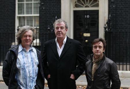 BBC automobile program Top Gear presenters James May (L), Jeremy Clarkson (C) and Richard Hammond pose outside 10 Downing Street in London November 29, 2011. REUTERS/Suzanne Plunkett
