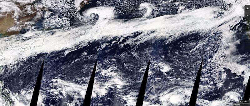 The composite image above, released by NASA, shows a large atmospheric river stretching from China on the left to the coast of North America on the right. (NASA)