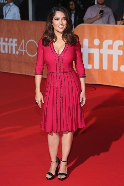 "<p>Although more casual than what her peers haven been wearing for the red carpet, Salma Hayek was still fancifully dressed in a red dress at the ""Septembers of Shiraz"" premiere.</p>"
