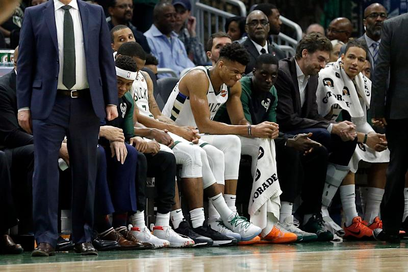 Milwaukee Bucks' Giannis Antetokounmpo grimaces from the bench during the second half of an NBA basketball game against the LA Clippers Thursday
