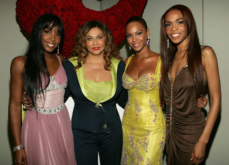 Tina Knowles designed the colorful clothing Destiny's Child. Pictured L - R: Kelly Rowland, Tina Knowles, Beyonce, Michelle Williams. (Photo: Getty Images)