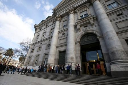 People line up outside Argentina's Banco Nacion (National Bank) before its opening, in Buenos Aires