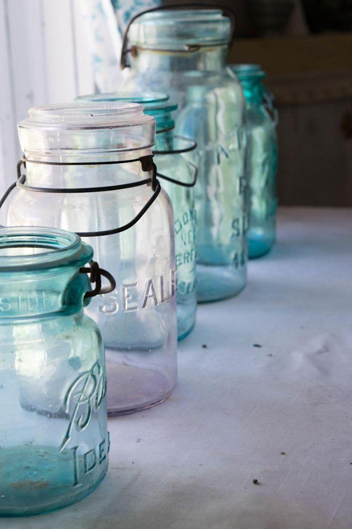 """<p>Invented in 1858 by John Landis Mason, these handy glass jars with the airtight seals were first used for canning. Nowadays the rarest kinds, like those stamped with an upside-down logo that were used as dispensers, could<a href=""""https://www.littlethings.com/valuing-mason-jars/4"""" rel=""""nofollow noopener"""" target=""""_blank"""" data-ylk=""""slk:sell for around $1,000."""" class=""""link rapid-noclick-resp""""> sell for around $1,000.</a></p>"""