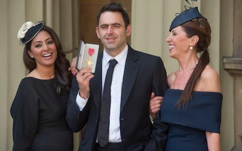 <span>Ronnie O'Sullivan receiving an O.B.E. in 2016 pictured with his mother Maria O'Sullivan (right) and partner Laila Rouass (left)</span> <span>Credit: JULIAN SIMMONDS </span>