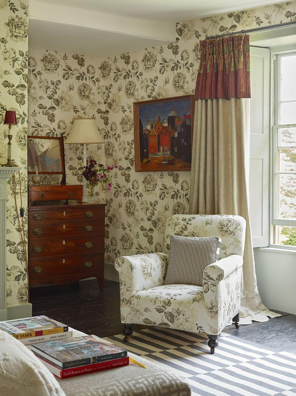 """<p>Textile designer Richard Smith loves to harness the power of sepia, especially in a bedroom. """"I've always loved the palette's simple beauty,"""" he says. """"And the red drapery pelmets add a bit of humor.""""</p>"""