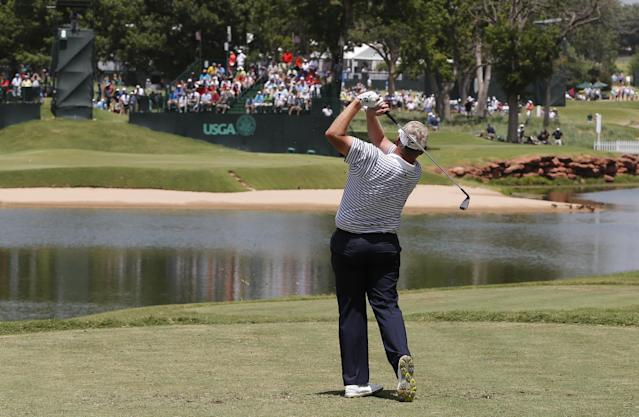Colin Montgomerie watches his shot from the eighth tee during the third round of play at the 2014 U.S. Senior Open golf tournament at Oak Tree National in Edmond, Okla., Saturday, July 12, 2014. (AP Photo/Sue Ogrocki)