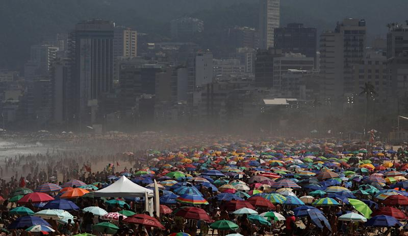 Sunbathers spend a sunny day, without keeping the social distance to prevent the spread of coronavirus, at the Ipanema beach in Rio de Janeiro on Sunday. Source: AP