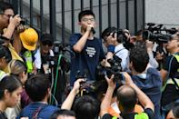 Pro-democracy activist Joshua Wong speaks to protesters outside the police headquarters in Hong Kong last summer