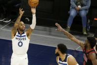 Minnesota Timberwolves guard D'Angelo Russell, left, shoots over Chicago Bulls forward Patrick Williams, right, with a pick from teammate Karl-Anthony Towns, center, in the second quarter during an NBA basketball game, Sunday, April 11, 2021, in Minneapolis. (AP Photo/Andy Clayton-King)