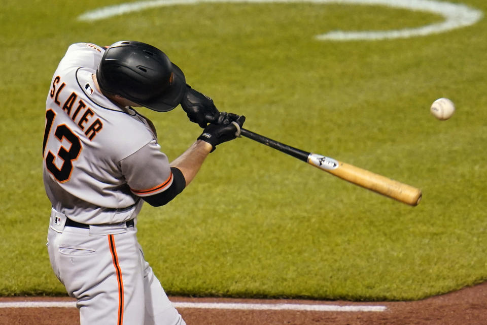 San Francisco Giants' Austin Slater drives in a run with a single off Pittsburgh Pirates relief pitcher Luis Oviedo during the 11th inning of a baseball game in Pittsburgh, Friday, May 14, 2021. (AP Photo/Gene J. Puskar)