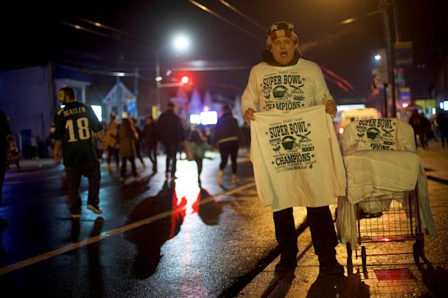 A man sells Super Bowl LII Champions T-shirts after the Philadelphia Eagles victory over the New England Patriots in Philadelphia, Pennsylvania U.S. February 4, 2018. REUTERS/Mark Makela