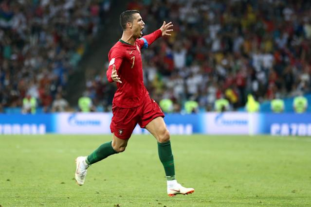 Cristiano Ronaldo celebrates his stunning free kick for Portugal against Spain at the 2018 World Cup. (Getty)