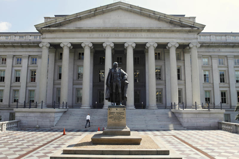 FILE - In this Monday, Aug. 8, 2011 file photo, a statue of former Treasury Secretary Albert Gallatin stands guard outside the Treasury Building in Washington. The rating agency Standard & Poor's stunned the world a year ago by stripping the U.S. government of its prized AAA bond rating. A year later, S&P's historic move looks like a non-event. Long-term interest rates are sharply lower, the Dow Jones industrial average has reversed course and is now up more than 1,600 points. The dollar has rallied, and gold prices are down from where they were when S&P lowered the boom (AP Photo/Jacquelyn Martin, File)