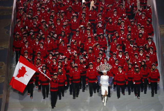 Canada's flag-bearer Hayley Wickenheiser leads her country's contingent during the opening ceremony of the 2014 Sochi Winter Olympics, February 7, 2014. REUTERS/David Gray (RUSSIA - Tags: OLYMPICS SPORT) ATTENTION EDITORS: PICTURE 19 OF 27 FOR PACKAGE 'SOCHI - EDITOR'S CHOICE' TO FIND ALL IMAGES SEARCH 'EDITOR'S CHOICE - 07 FEBRUARY 2014'