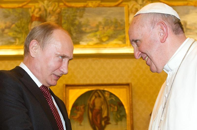 Russian President Vladimir Putin (left) held a private audience with Pope Francis during a 2013 visit to the Vatican