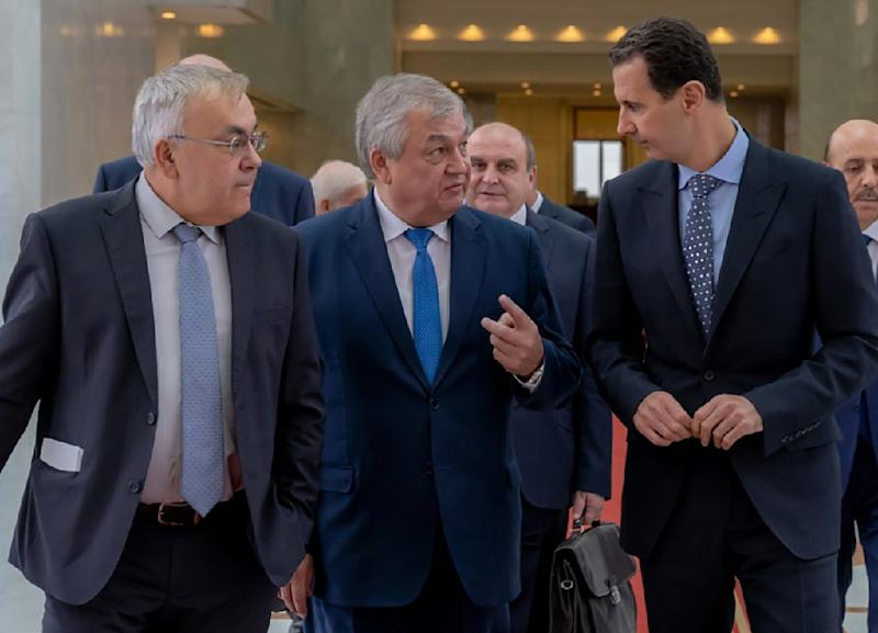 This handout picture made available by the Syrian Presidency Telegram page on November 4, 2018 shows Syrian President Basah al-Assad (R) receiving Russian special envoy to Syria Alexander Lavrentiev (C) in the Syrian capital Damascus
