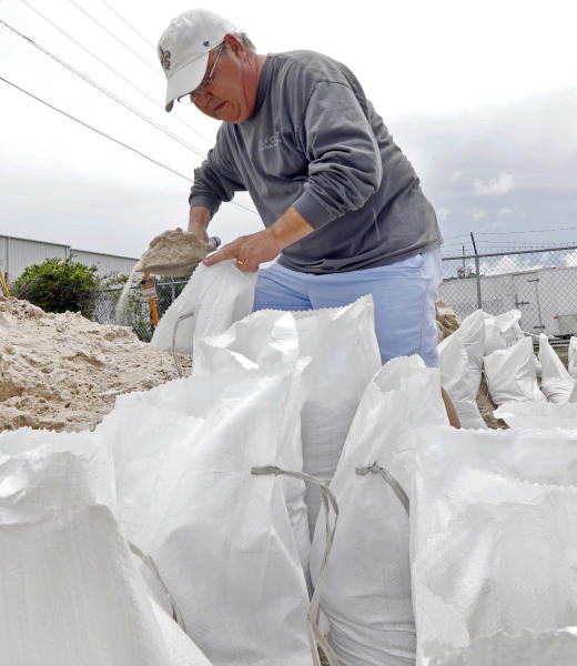 Eddy Warner loads sand bags as he waits for family members to assist and tie off and load the bags into his vehicle, while preparing for Subtropical Storm Alberto to make its way through the Gulf of Mexico in Gulfport, Miss., Saturday, May 26, 2018. Warner will use the bags as a barrier to keep water from flooding his garage. The slow moving storm is threatening to bring heavy rainfall, storm surges, high wind and flash flooding this holiday weekend. (AP Photo/Rogelio V. Solis)
