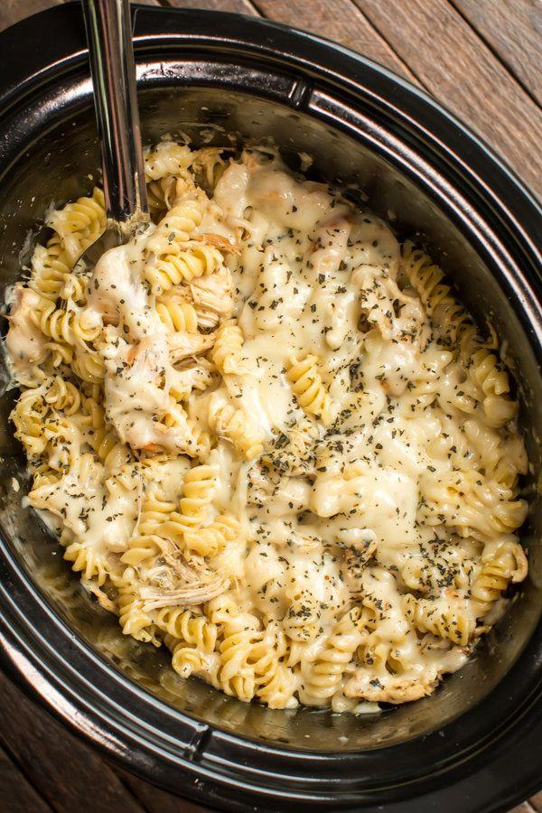 """<strong>Get the <a href=""""http://www.themagicalslowcooker.com/slow-cooker-pesto-mozzarella-chicken-pasta/"""" target=""""_blank"""">Slow Cooker Pesto Mozzarella Chicken Pasta recipe</a>from The Magical Slow Cooker</strong>"""