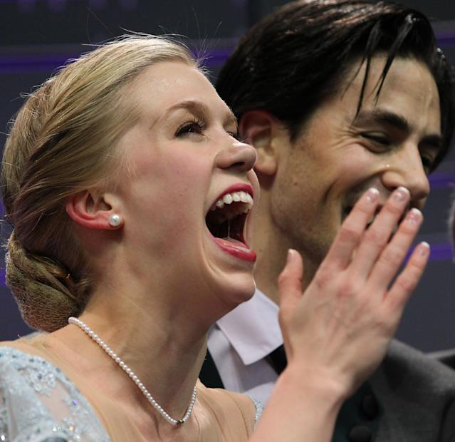 LONDON, CANADA - MARCH 14: Kaitlyn Weaver and Andrew Poje of Canada react to their score after their skate in the Ice Dance Short Dance Program during the 2013 ISU World Figure Skating Championships at Budweiser Gardens on March 14, 2013 in London, Ontario, Canada. (Photo by Dave Sandford/Getty Images)