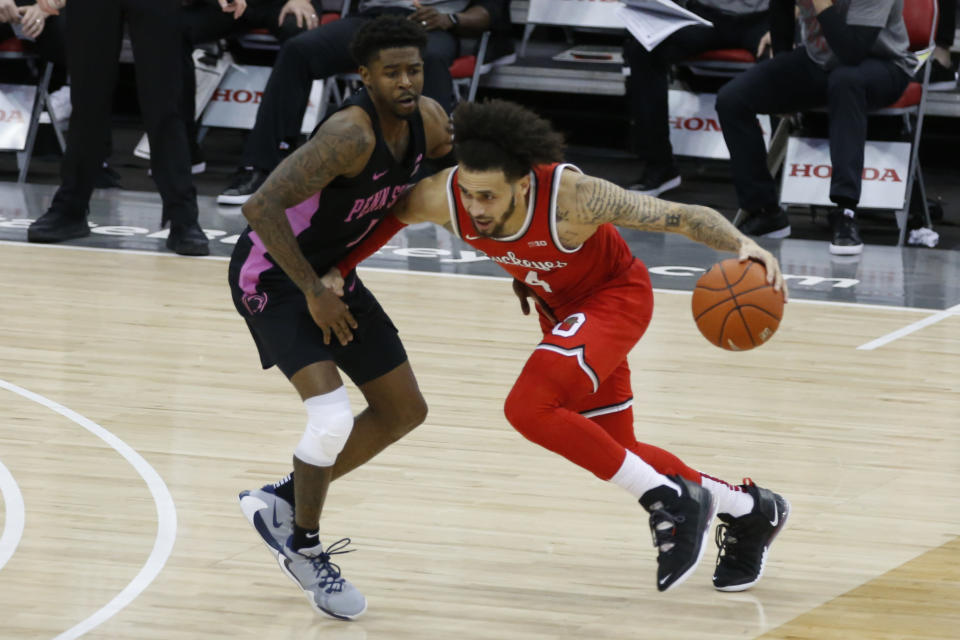Ohio State's Duane Washington, right, dribbles the ball up court against Penn State's Jamari Wheeler during the second half of an NCAA college basketball game Wednesday, Jan. 27, 2021, in Columbus, Ohio. Ohio State beat Penn State 83-79. (AP Photo/Jay LaPrete)
