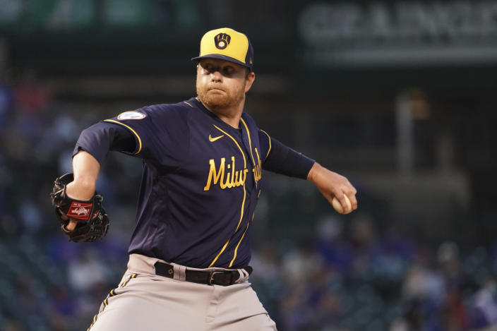 Milwaukee Brewers starting pitcher Brett Anderson (25) throws the ball against the Chicago Cubs during the third inning of a baseball game, Monday, April, 5, 2021, in Chicago. (AP Photo/David Banks)