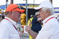 FILE - Team owners Chip Ganassi, left, and Roger Penske, right, greet each other on pit road before an IndyCar auto race at Texas Motor Speedway in Fort Worth, Texas, in this Saturday, June 8, 2019, file photo. The IndyCar series begins with the Grand Prix of Alabama at Barber Motorsports Park in Birmingham on April 18. (AP Photo/Randy Holt, File)