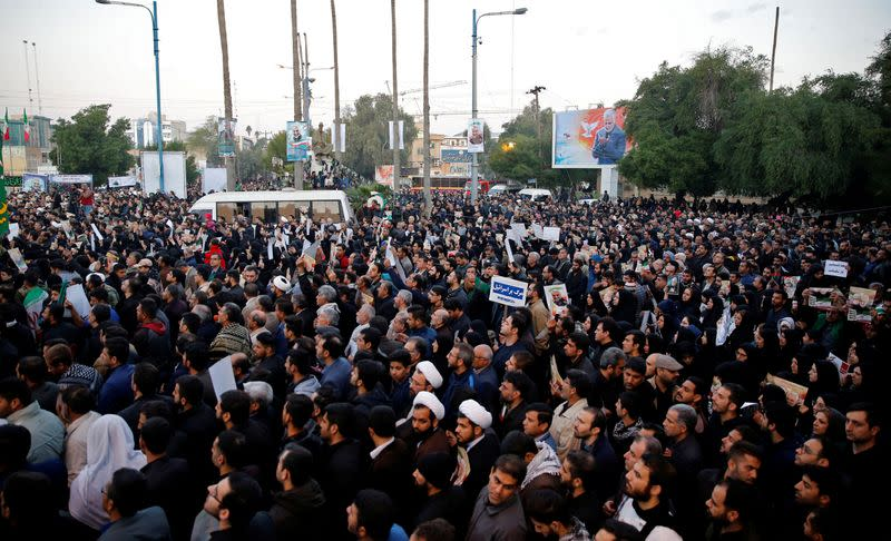 People attend a funeral procession for Soleimani and al-Muhandis, in Ahvaz