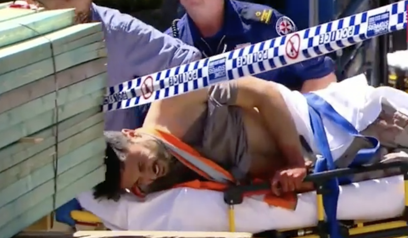 Antony Metledge is loaded into an ambulance at the construction site. Source: Nine News