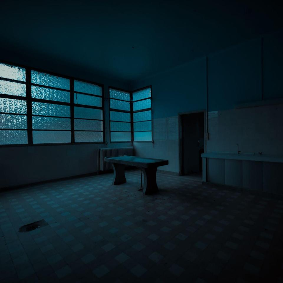<p>Dusk turns to night in this bare exam room.</p>