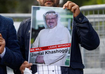 REPRESENTATIVE IMAGE: A demonstrator holds picture of Saudi journalist Jamal Khashoggi during a protest in front of Saudi Arabia's consulate in Istanbul, Turkey, October 5, 2018. REUTERS/Osman Orsal