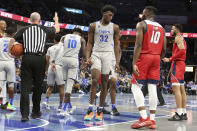 Memphis' James Wiseman (32) take his position on the floor during the second half of an NCAA college basketball game against Illinois-Chicago, Friday, Nov. 8, 2019, in Memphis, Tenn. (AP Photo/Karen Pulfer Focht)