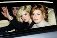 British rock singer Ozzy Osbourne (L) with daughter Kelly (C) and wife Sharon (R) arrive for a pre-World Cup party at the Herfordshire home of David and Victoria Beckham in southern England May 21, 2006. REUTERS/Luke MacGregor