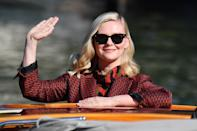 <p>Kirsten Dunst waves hello as she arrives at the 78th annual Venice International Film Festival on Sept. 1 in Venice. </p>