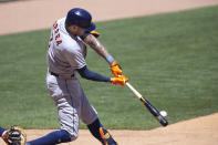 Houston Astros shortstop Carlos Correa hits a single in the fourth inning of a baseball game against the Minnesota Twins, Sunday, June 13, 2021, in Minneapolis. (AP Photo/Andy Clayton-King)