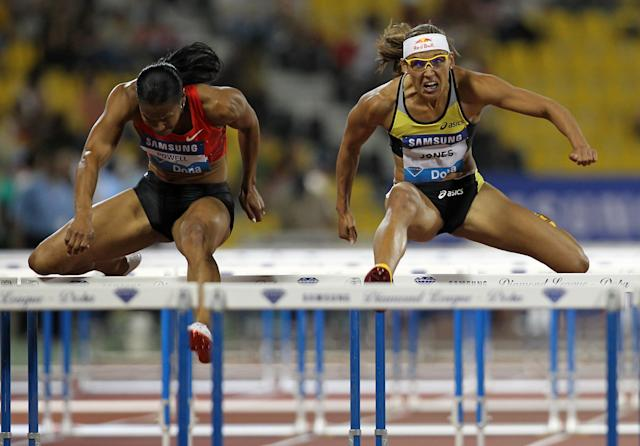 Virginia Powell-Crawford (L) and Lolo Jones of the US compete in the women's 100m hurdles at the IAAF Diamond League in Doha on May 6, 2011. AFP PHOTO/KARIM JAAFAR (Photo credit should read KARIM JAAFAR/AFP/Getty Images)