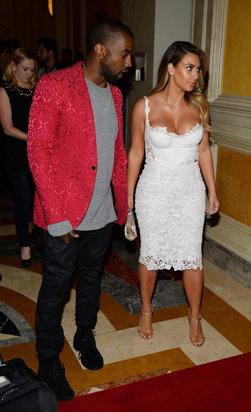 LAS VEGAS, NV - OCTOBER 26: Rapper Kanye West (L) and television personality Kim Kardashian arrive at the Tao Nightclub at The Venetian Las Vegas to celebrate Kardashian's 33rd birthday on October 26, 2013 in Las Vegas, Nevada. (Photo by Ethan Miller/Getty Images)