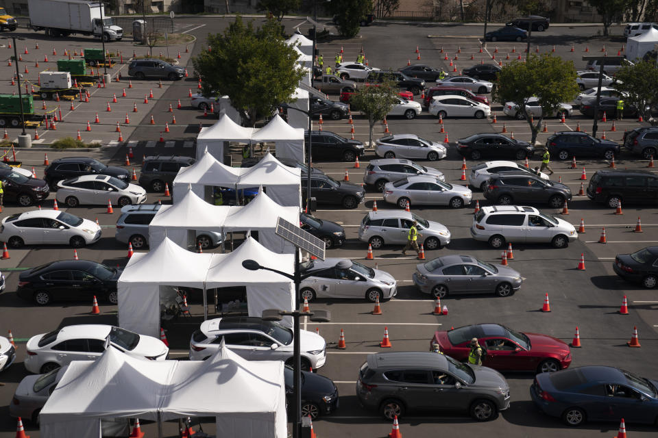 Motorists line up for their COVID-19 vaccine a joint state and federal mass vaccination site set up on the campus of California State University of Los Angeles in Los Angeles,Tuesday, Feb. 16, 2021. (AP Photo/Jae C. Hong)