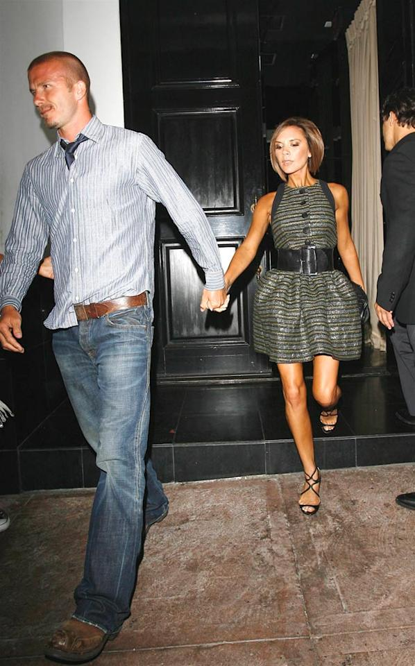 "Becks looks dapper in denim and brown leather, while Posh sashays in a striped dress and wide belt. AlphaX/<a href=""http://www.x17online.com"" target=""new"">X17 Online</a> - August 11, 2008"