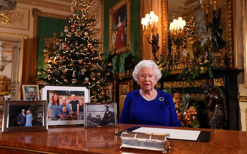 The Sussexes were absent from photos in the Queen's Christmas Day message - STEVE PARSONS/AFP