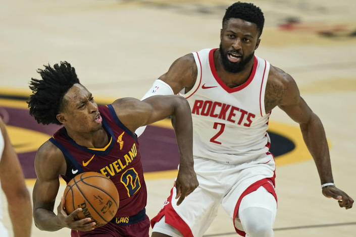 Cleveland Cavaliers' Collin Sexton, left, drives against Houston Rockets' David Nwaba in the first half of an NBA basketball game, Wednesday, Feb. 24, 2021, in Cleveland. (AP Photo/Tony Dejak)