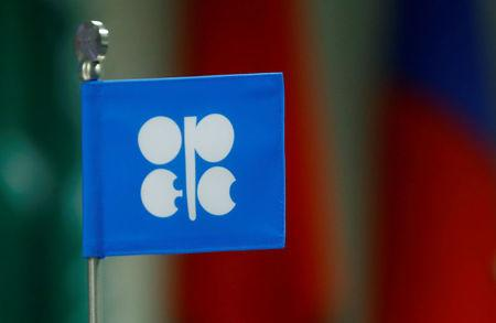 FILE PHOTO: A flag with the Organization of the Petroleum Exporting Countries (OPEC) logo is seen during a meeting of OPEC and non-OPEC producing countries in Vienna, Austria September 22, 2017.  REUTERS/Leonhard Foeger/File Photo