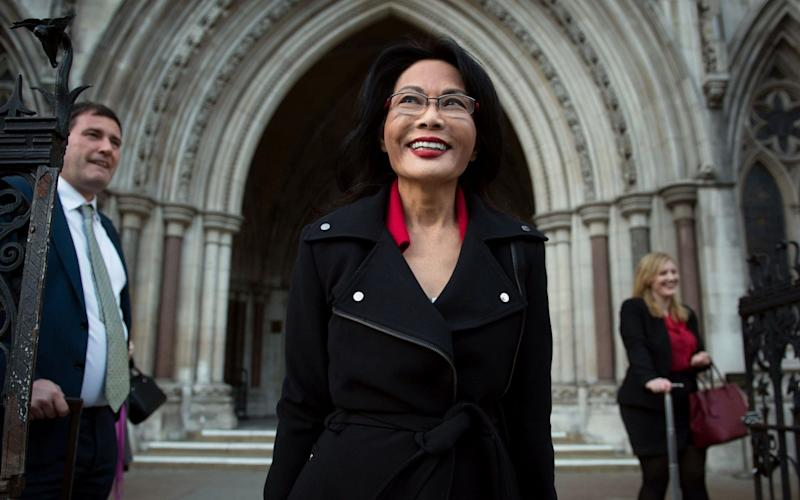 Pauline Chai, estranged wife of Khoo Kay Peng, non-executive chairman of Laura Ashley Holdings, leaving the High Court in London - PA